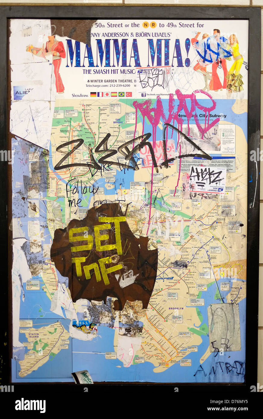 a vandalized new york city subway map on the wall of a station in brooklyn
