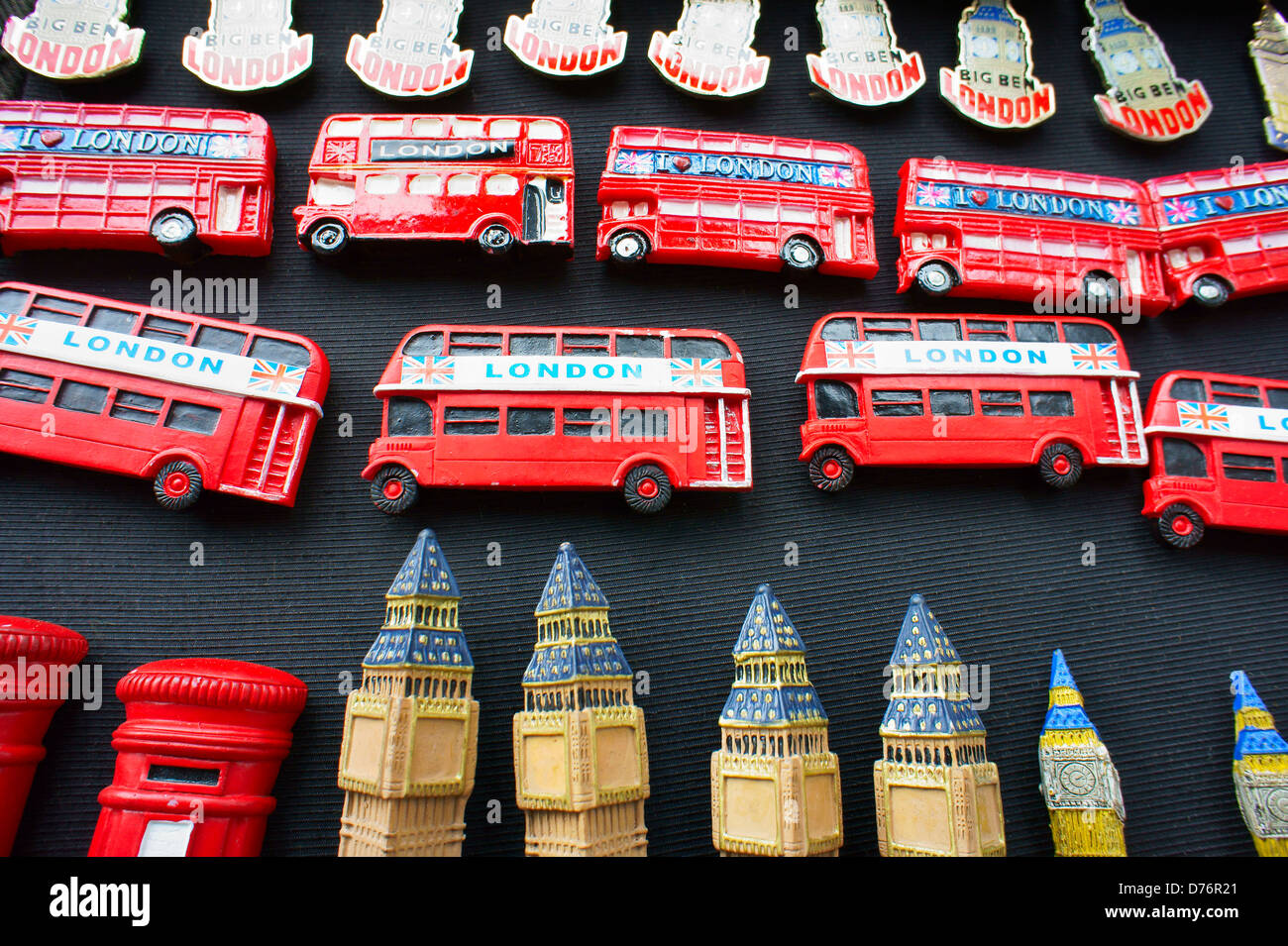London, England tourist holiday souvenirs fridge magnet badges. Red bus, telephone box kiosk and Big Ben - Stock Image