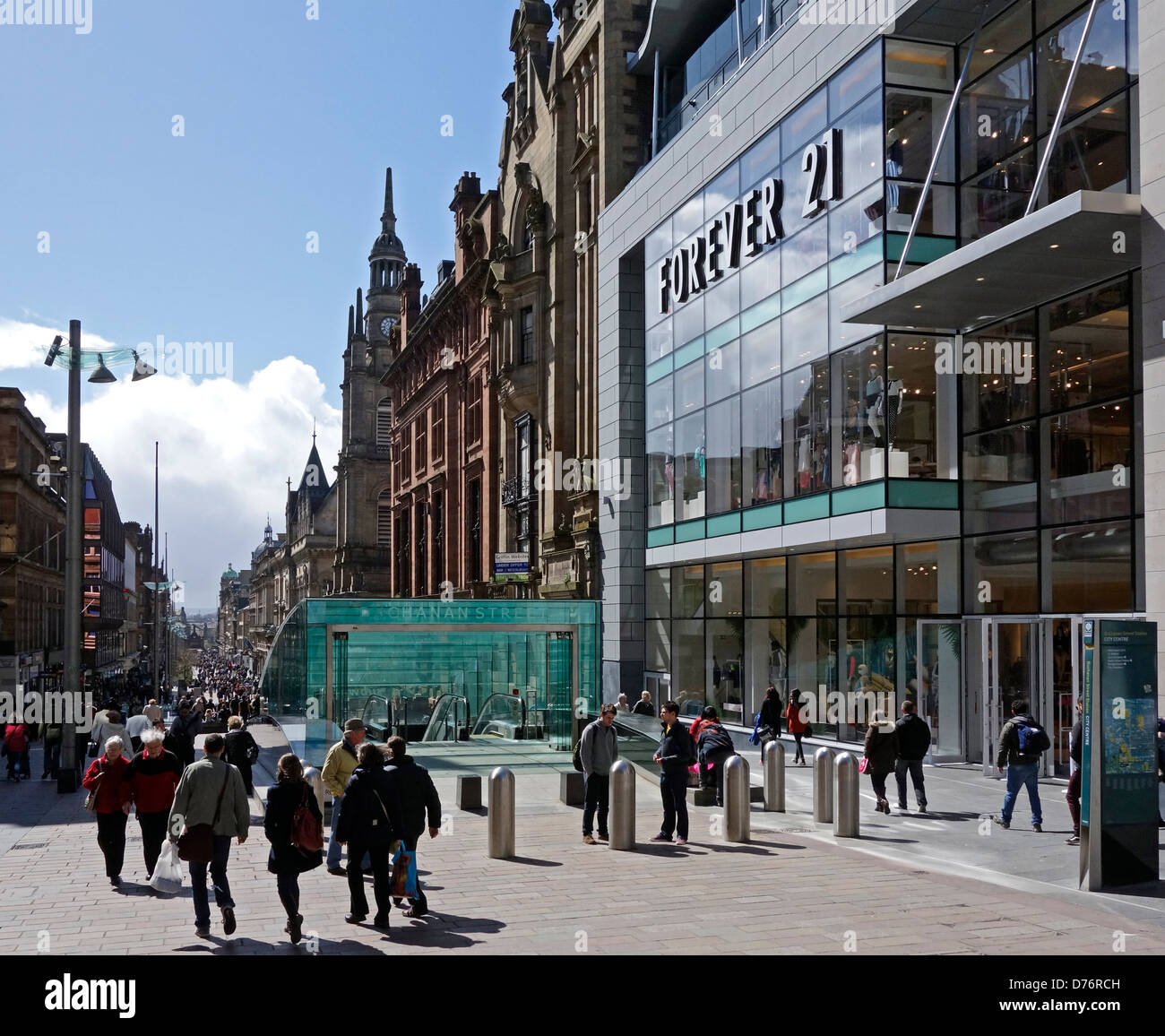 Visitors and shoppers in Buchanan Street Glasgow Scotland with entrance to Glasgow Subway centre. - Stock Image