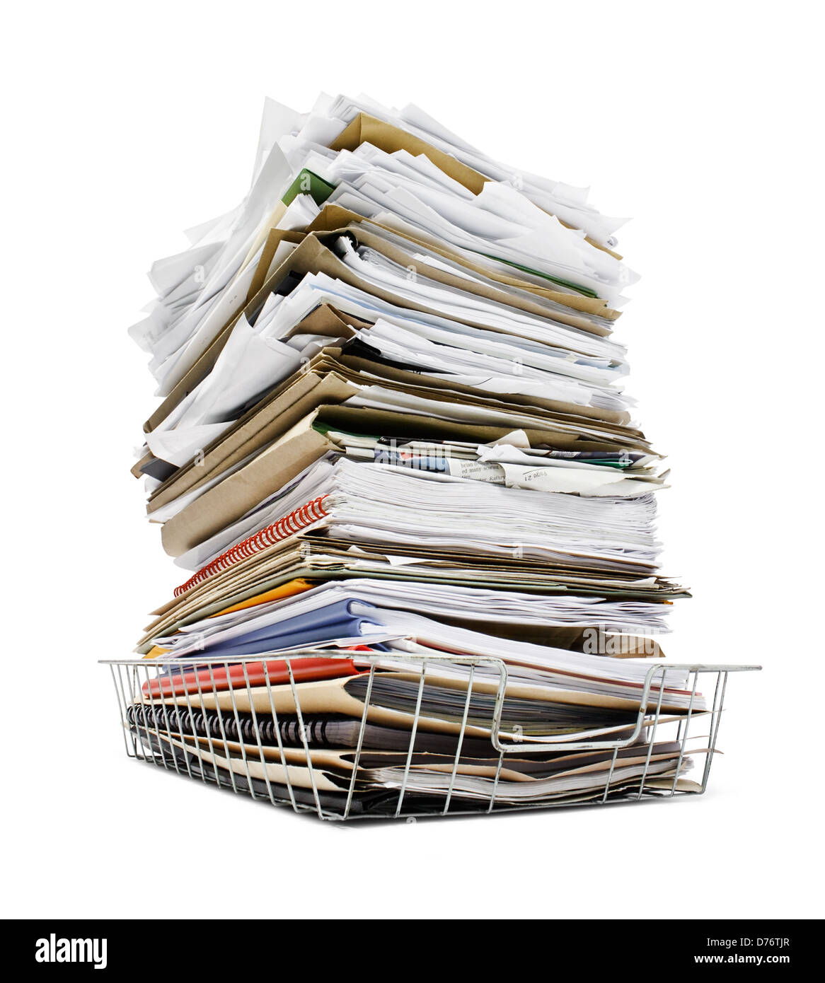 office in tray piled high with a large amount of overwhelming work good concept for stress - Stock Image