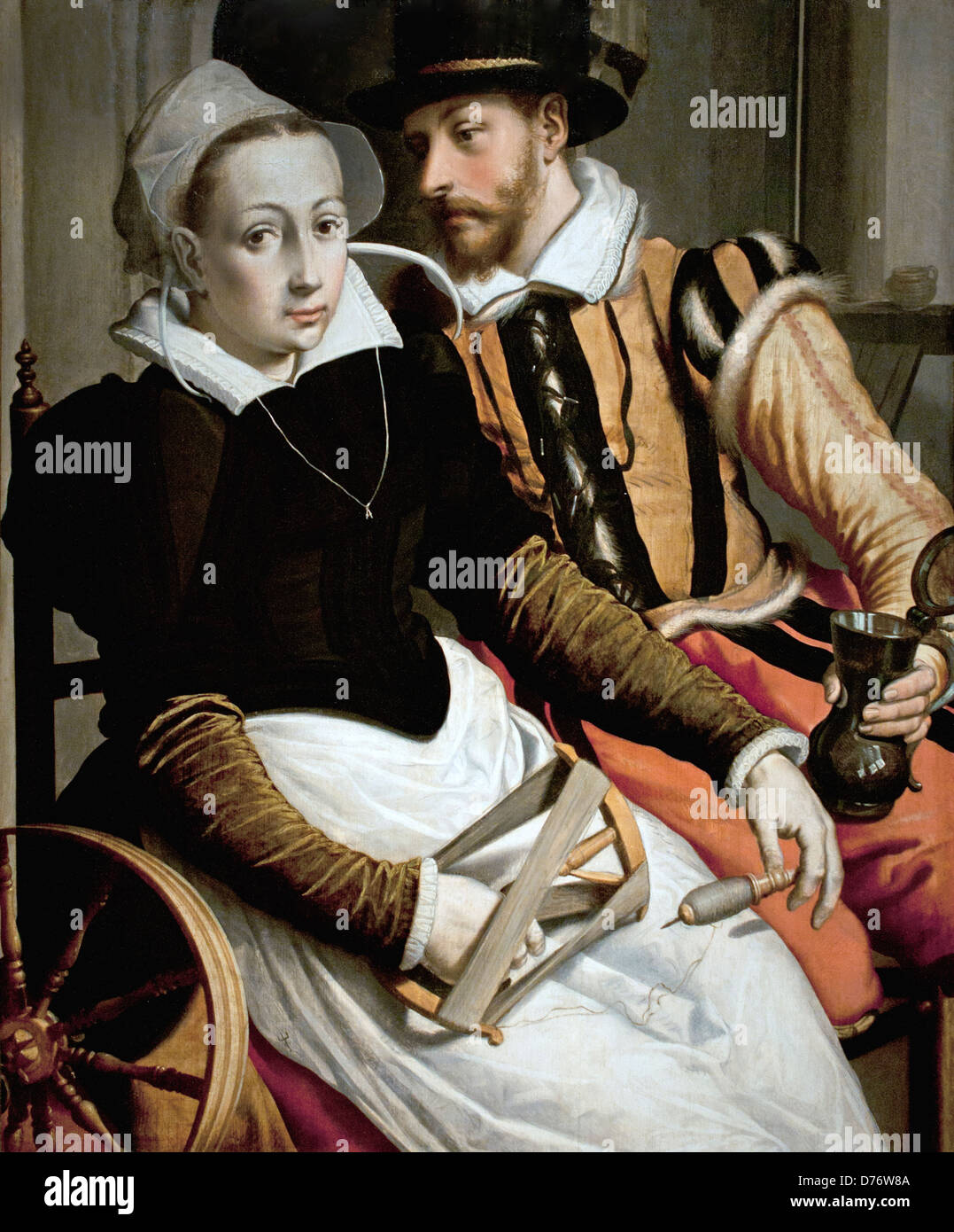 A woman at the spinning wheel and a man with a mug seated in an interior.1560 Pieter Pietersz the Elder Dutch Netherlands Stock Photo