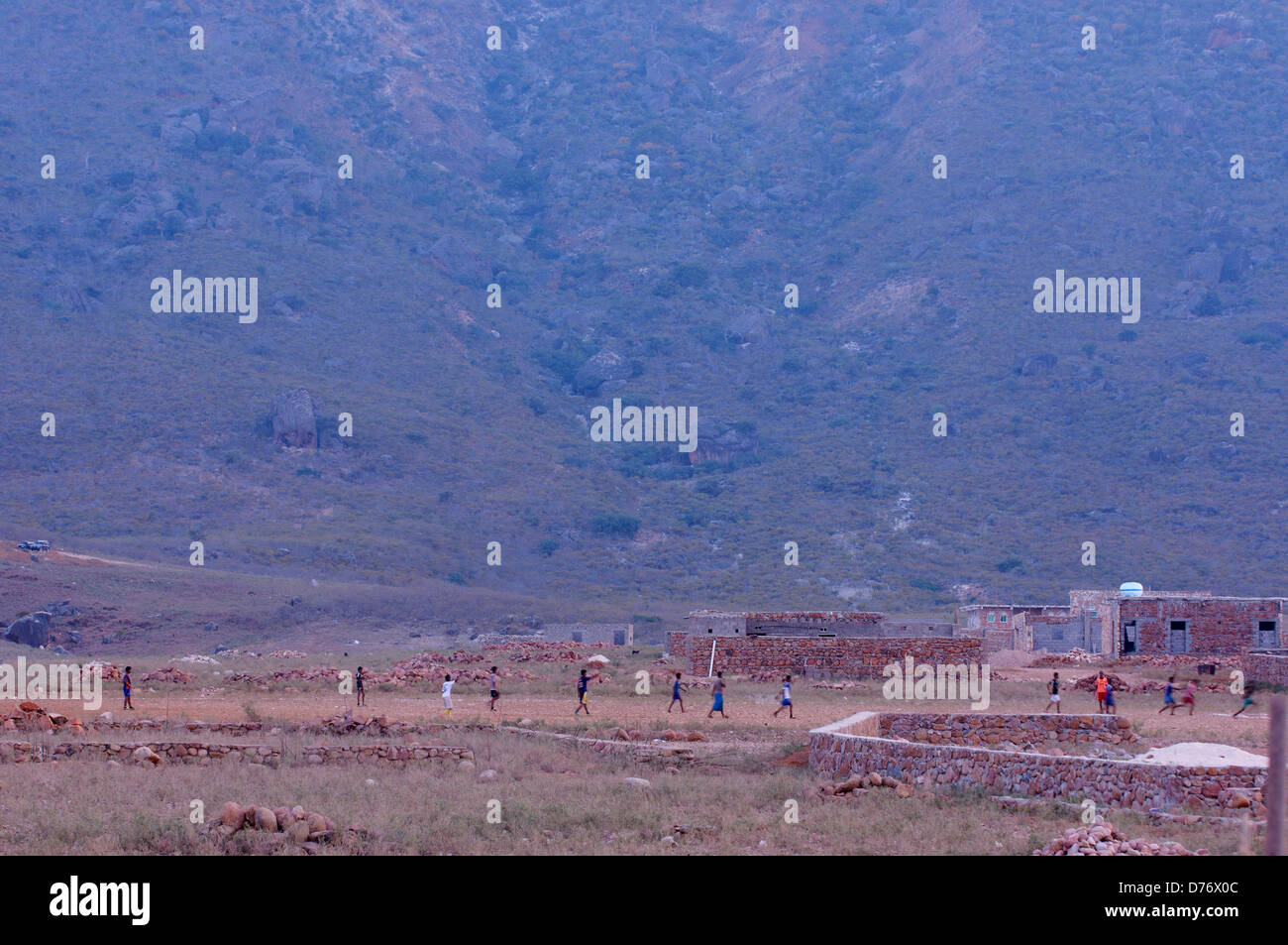 Children playing football on Socotra - Stock Image