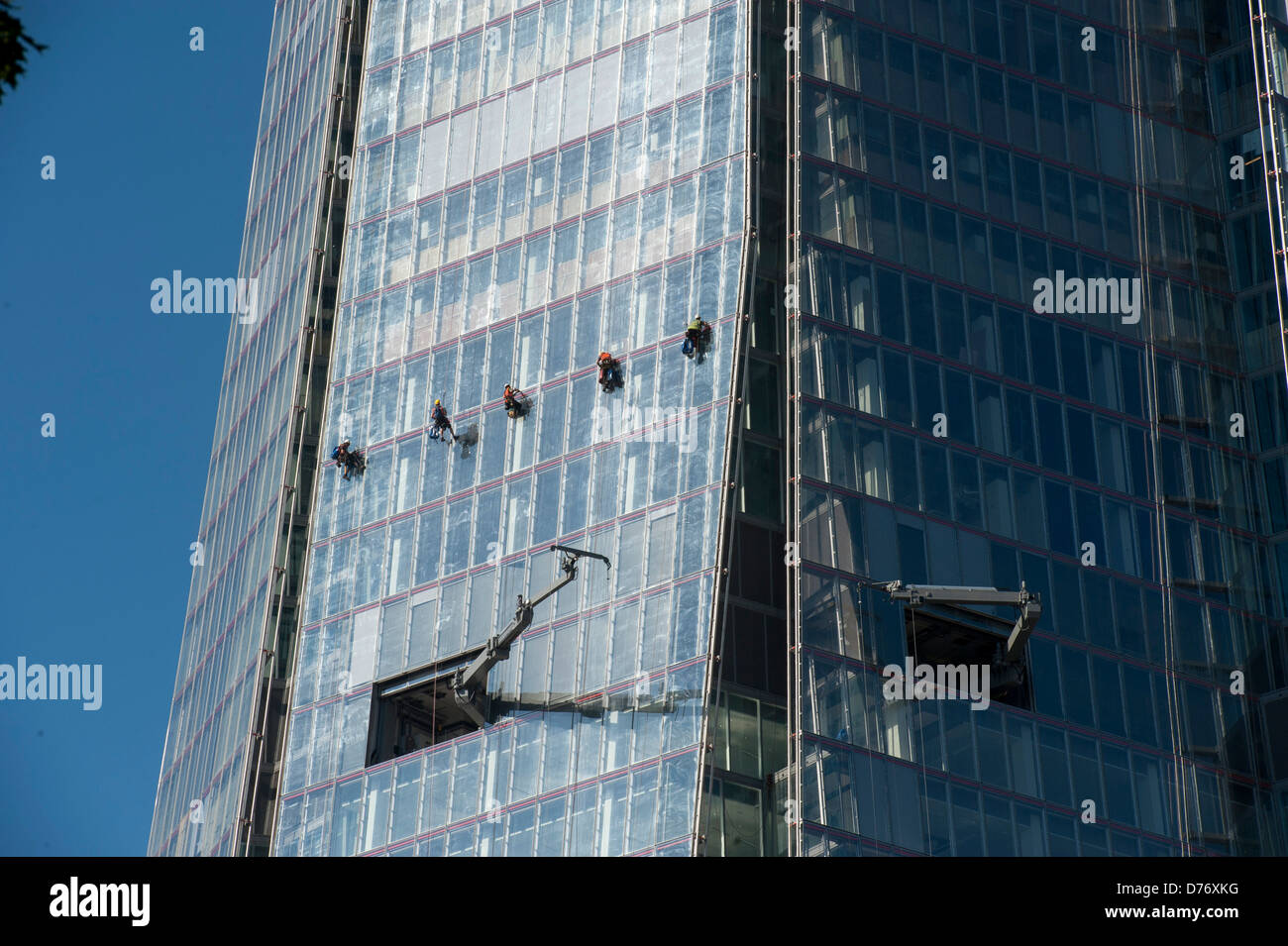 five abseiling window cleaners The Shard dangling Stock Photo