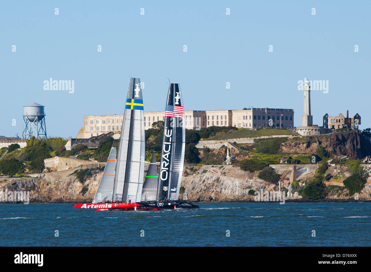 Yachts competing in the America's Cup in 2013 practice in front of Alcatraz, San Francisco, USA - Stock Image