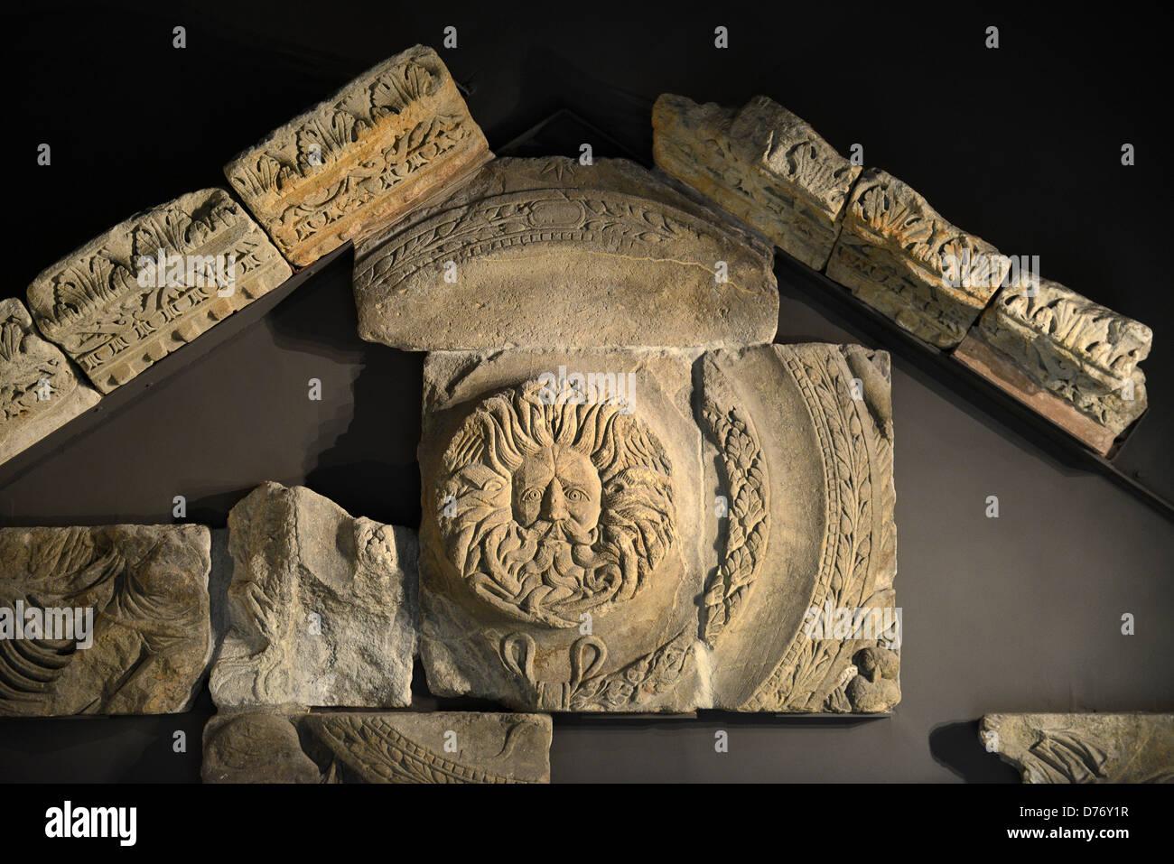 Gorgon's head stonework at Roman Baths in Bath, Somerset, England - Stock Image