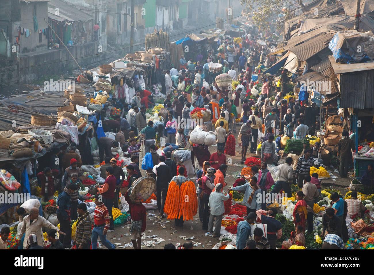 Colorful flower market at Mullick ghat near Howrah Bridge in Kolkata, India. - Stock Image