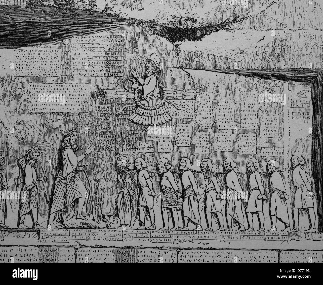 Behistun Inscription, relief with an inscription about Darius I, Bistun in Kermanshah, Iran, woodcut from 1880 - Stock Image