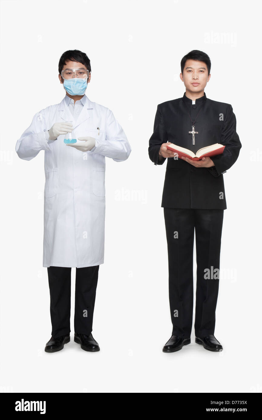 Priest and scientist - Stock Image