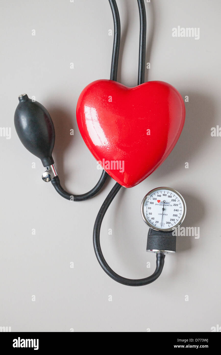 heart with blood pressure cuff - Stock Image