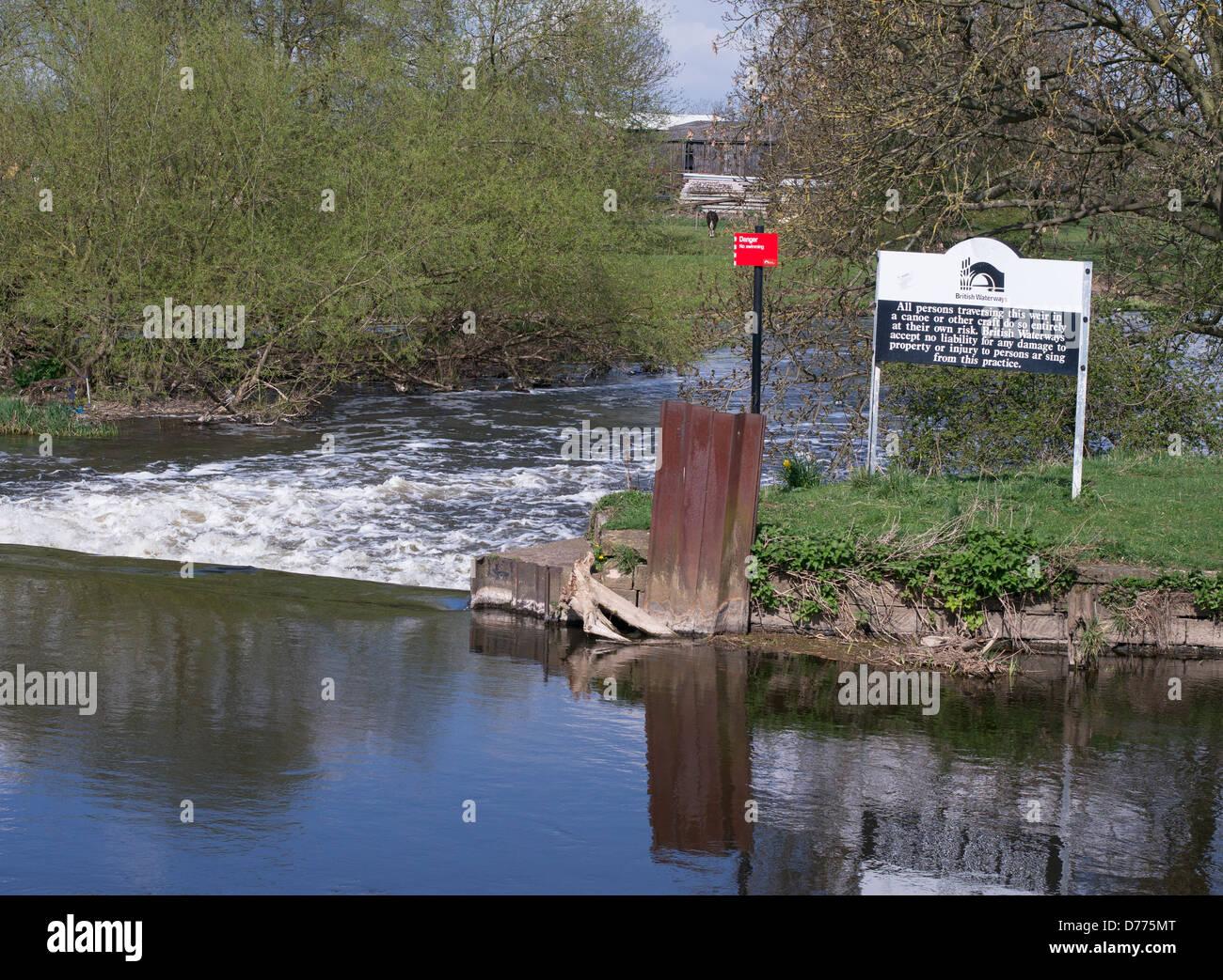 British Waterways warning sign at weir Newark England UK - Stock Image