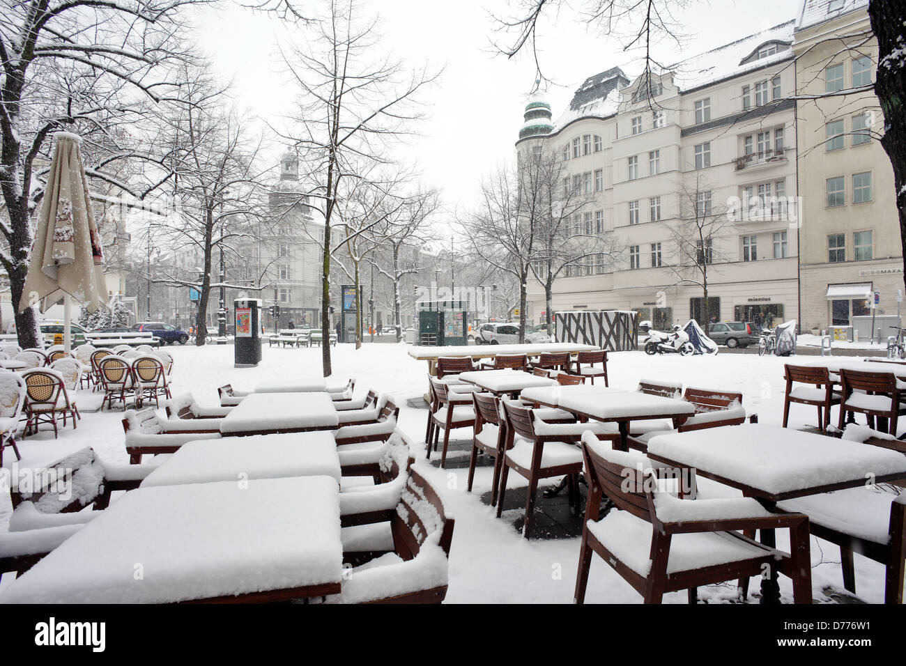 Berlin, Germany, snowed-in furniture of a street cafes on the Place George Grosz - Stock Image