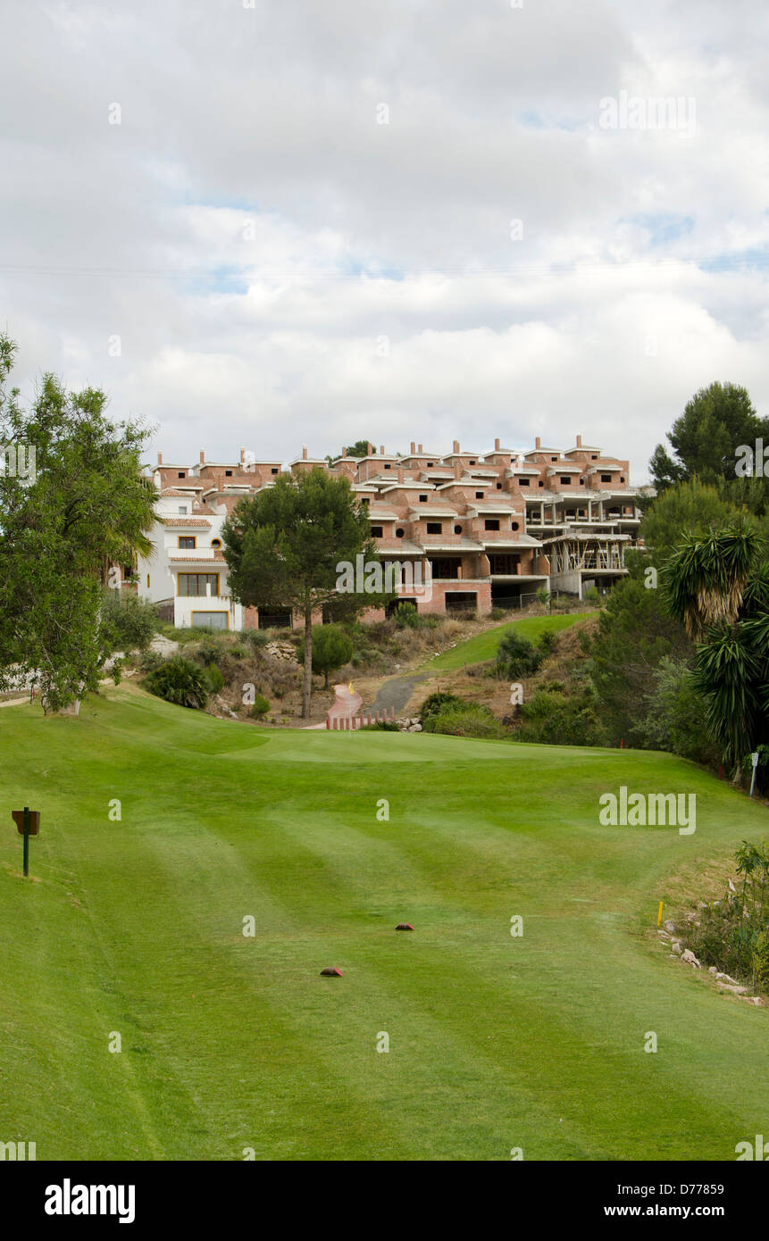 Unfinished town houses next to par 3 golf course in Spain - Stock Image