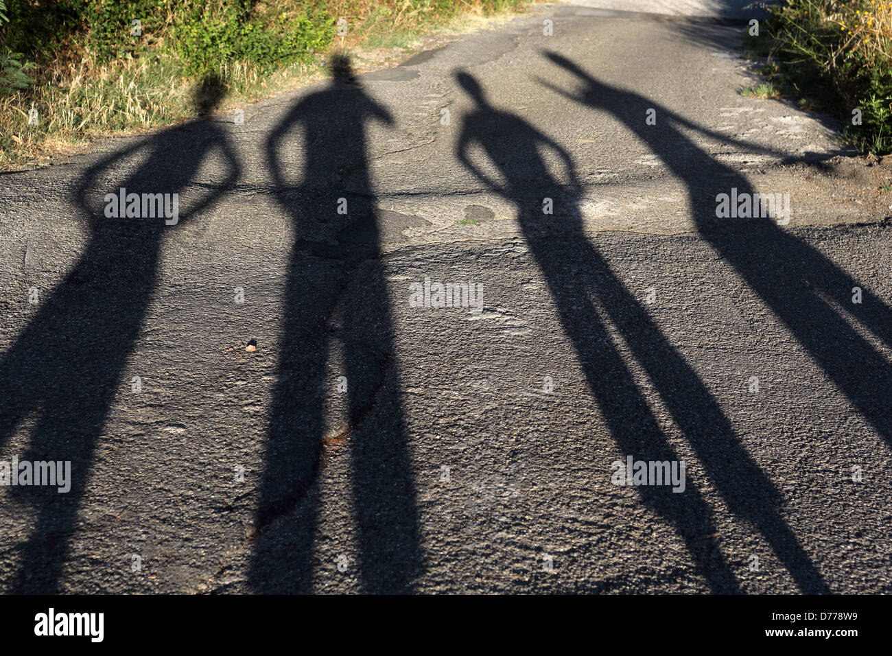 Torre Alfina, Italy, people throw shadows on the asphalt - Stock Image
