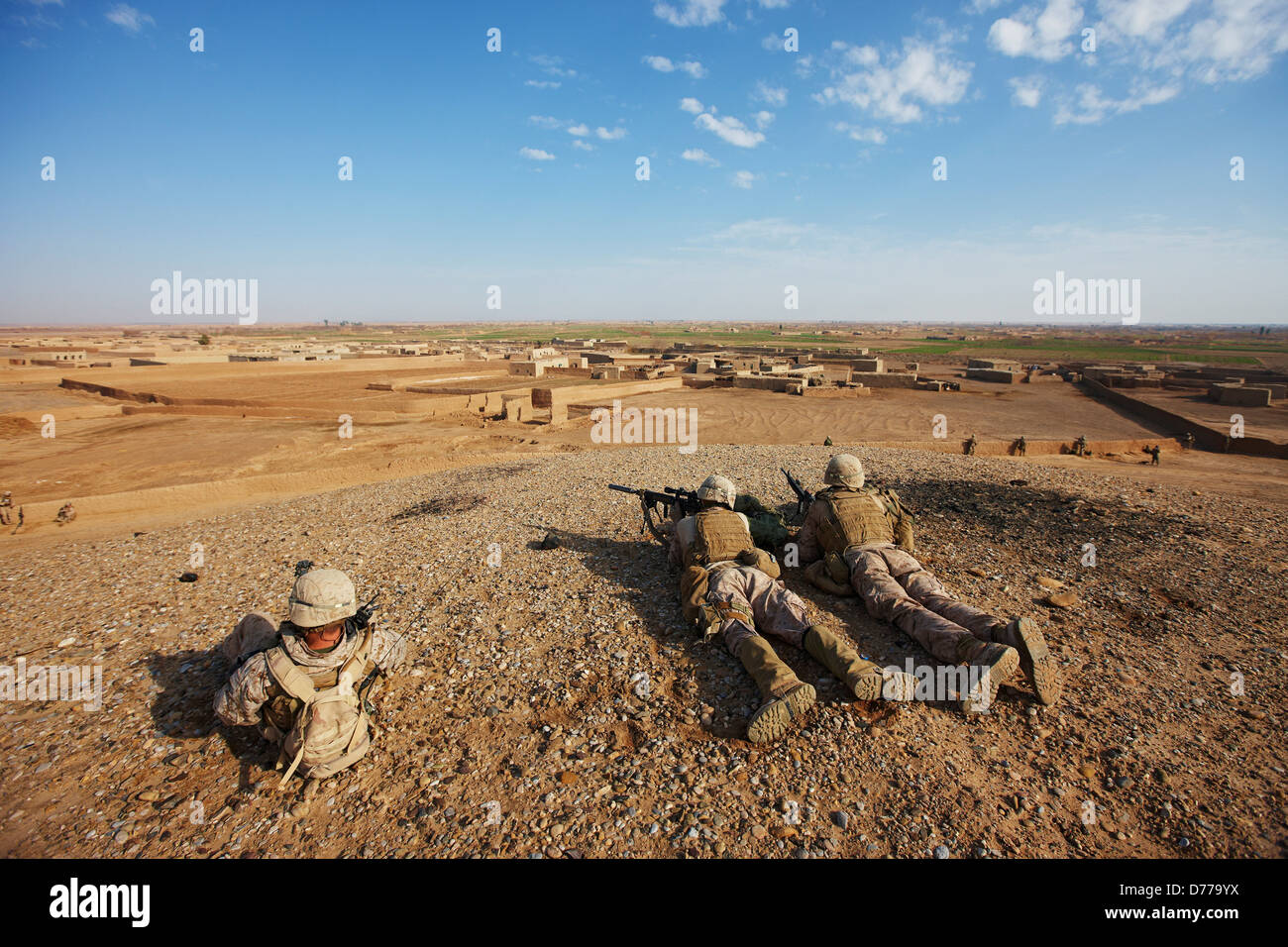 U.S. Marine Corps Designated Marksmen Overlook Town in Afghanistan's Helmand Province During Combat Operation - Stock Image