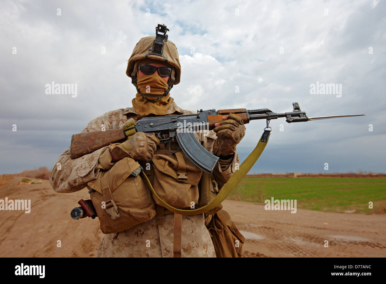 A U.S. Marine Poses Militia Fighter's AK47 Fitted Bayonet at Combat Outpost in Afghanistan's Helmand Province. - Stock Image