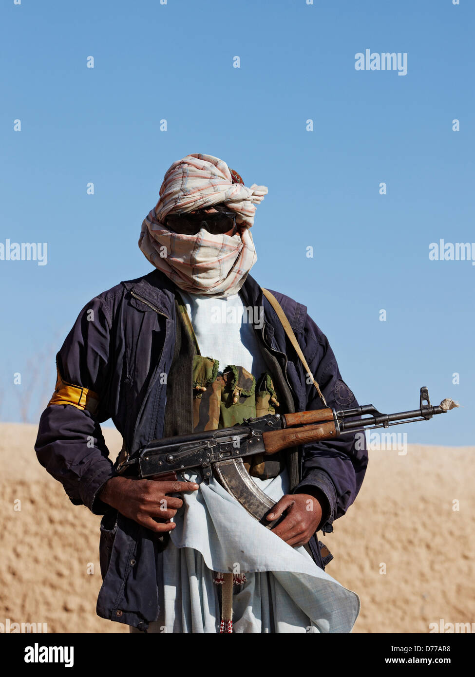 A Militia Member Holds AK47 Assault Rifle During Combat Operation in Afghanistan's Helmand Province - Stock Image