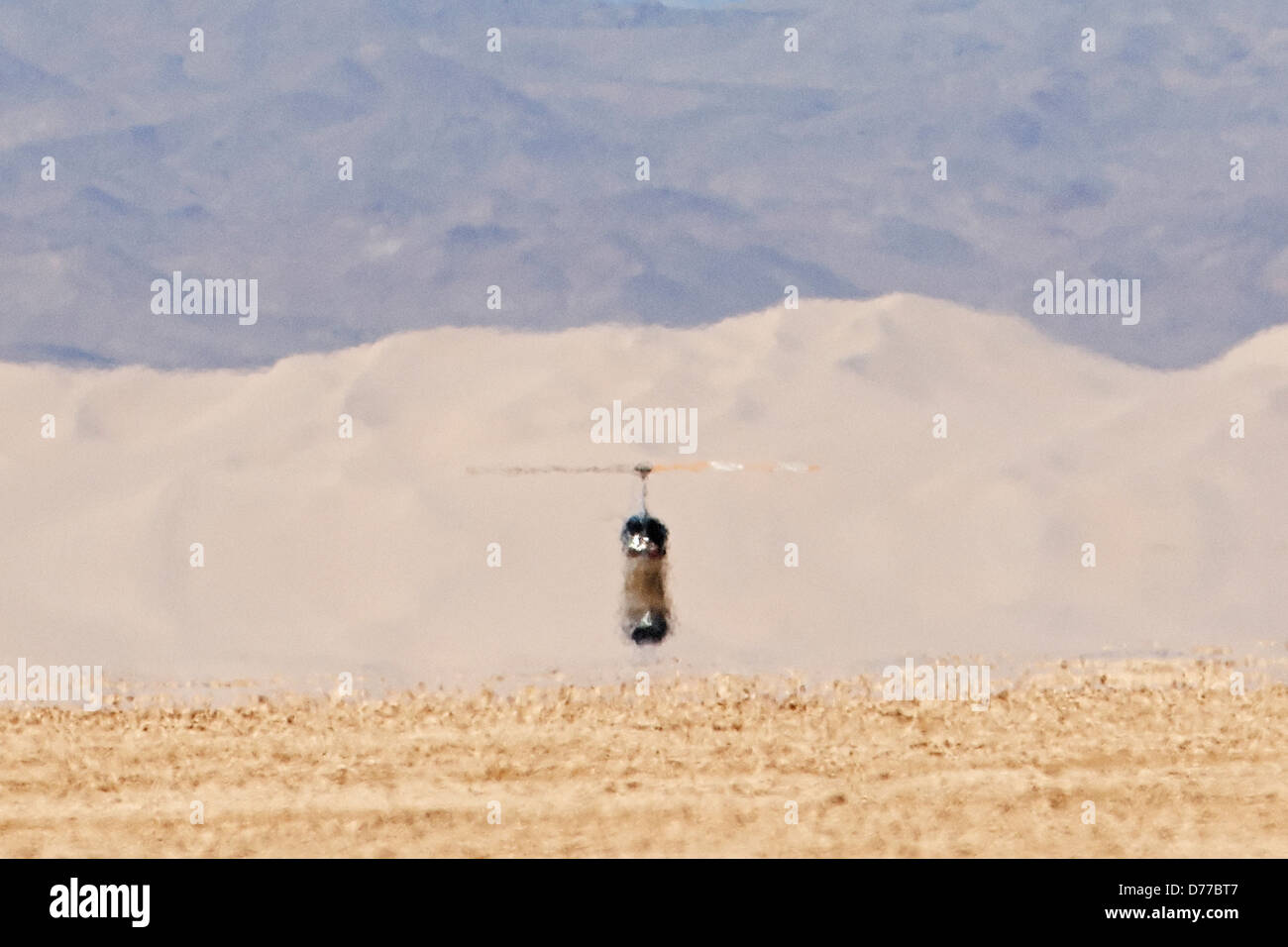 Helicopter Distant Sand Dunes Visually Obscured By Inferior Mirage - Stock Image