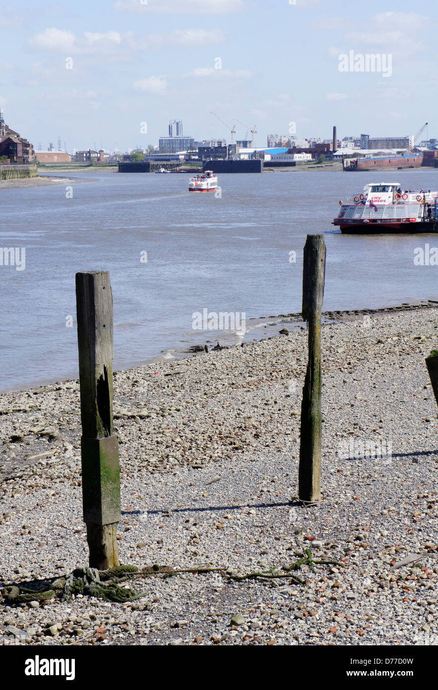 Exposed timbers at low tide, Thames foreshore, Greenwich, London, England - Stock Image
