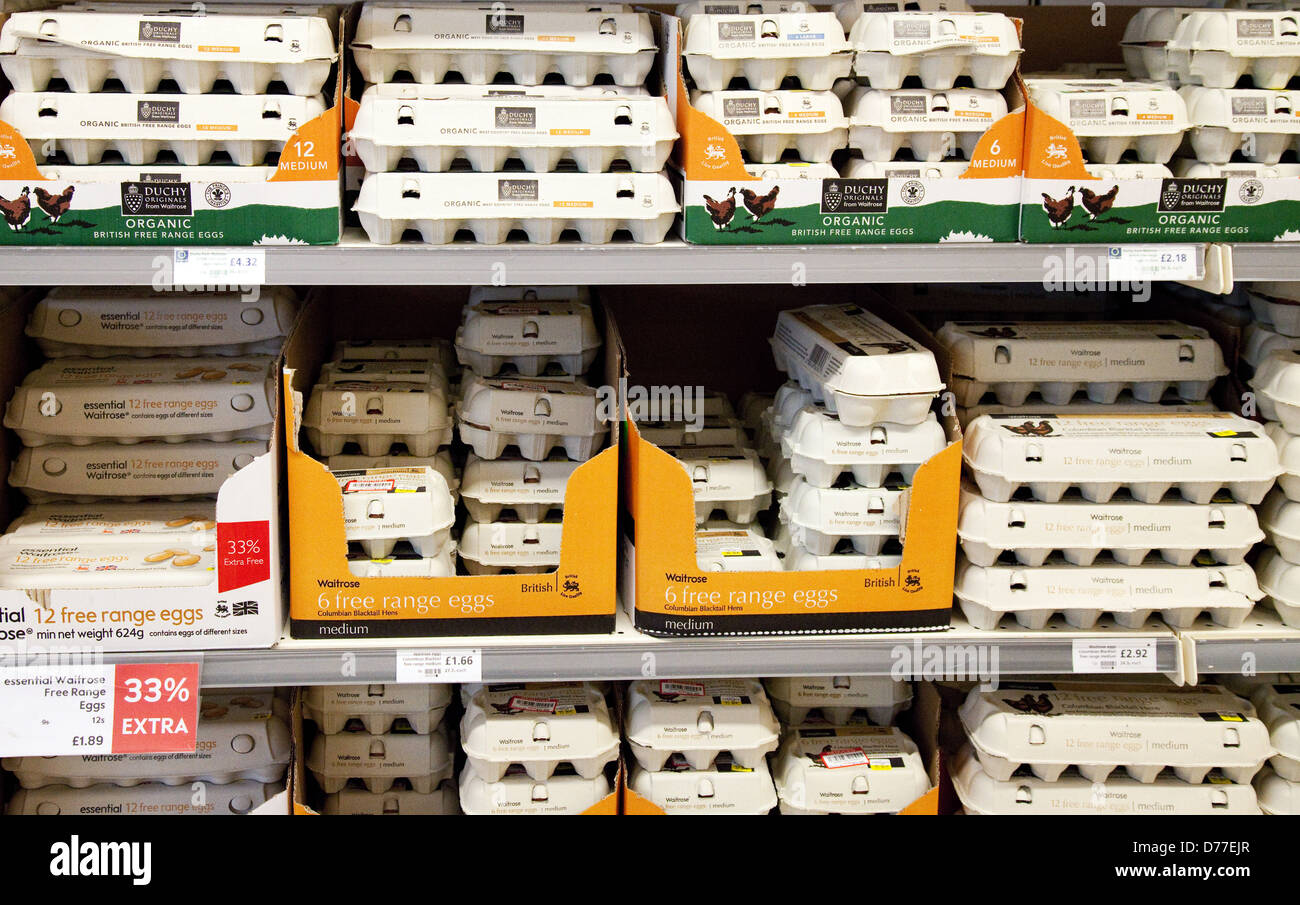 Boxes of eggs for sale on a supermarket shelf, Waitrose UK Stock Photo