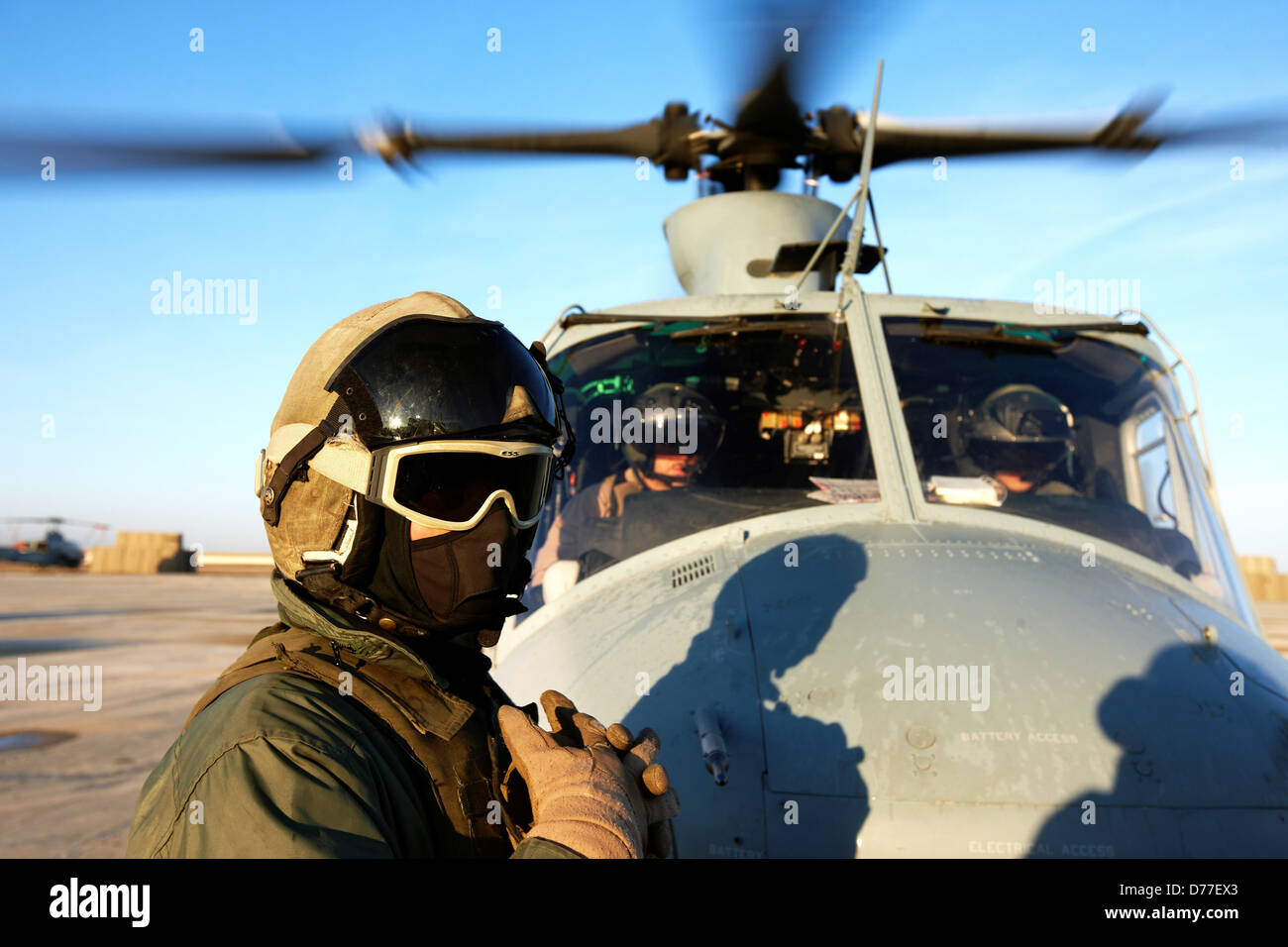 United States Marine Corps aviators ground crew prepare to launch UH-1Y Venom helicopter on combat operation in - Stock Image