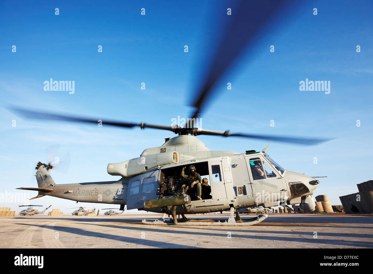 United States Marine Corps UH-1Y Venom helicopter prepares to launch on combat operation in Helmand Province Afghanistan - Stock Image