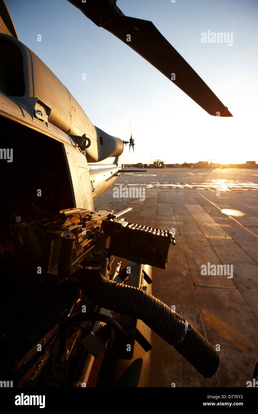 View 50 caliber machine gun rocket pod mounted to side United States Marine Corps UH-1Y Venom just prior to launching - Stock Image