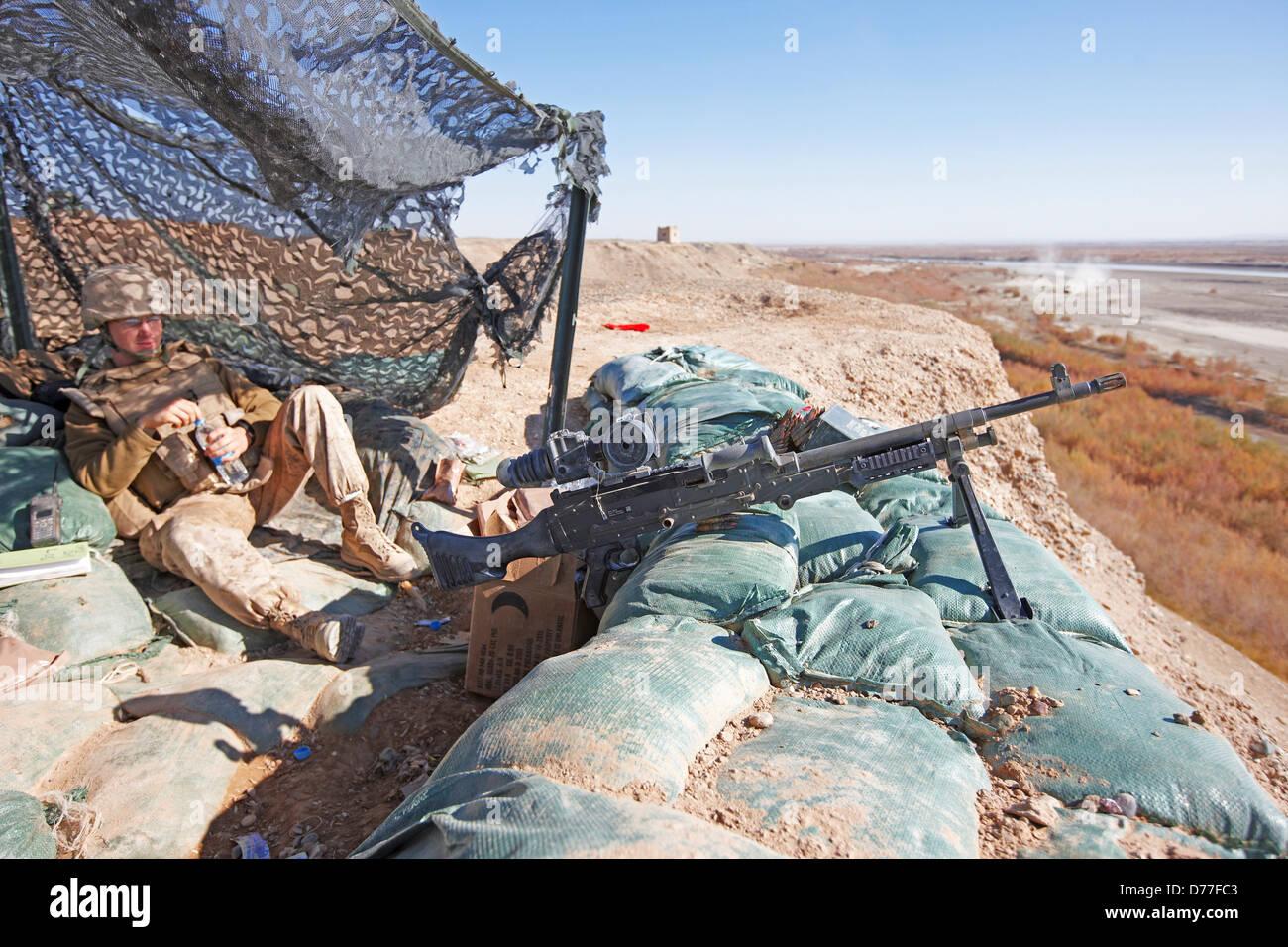 United States Marine in machine gun bunker M240B medium ...