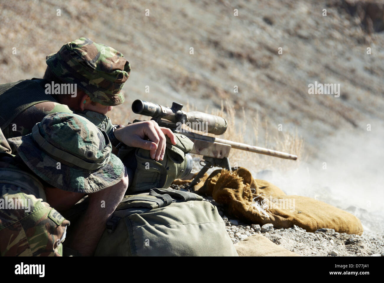 British Royal Marine firing sniper rifle during mountain sniper training Hawthorne Nevada USA - Stock Image