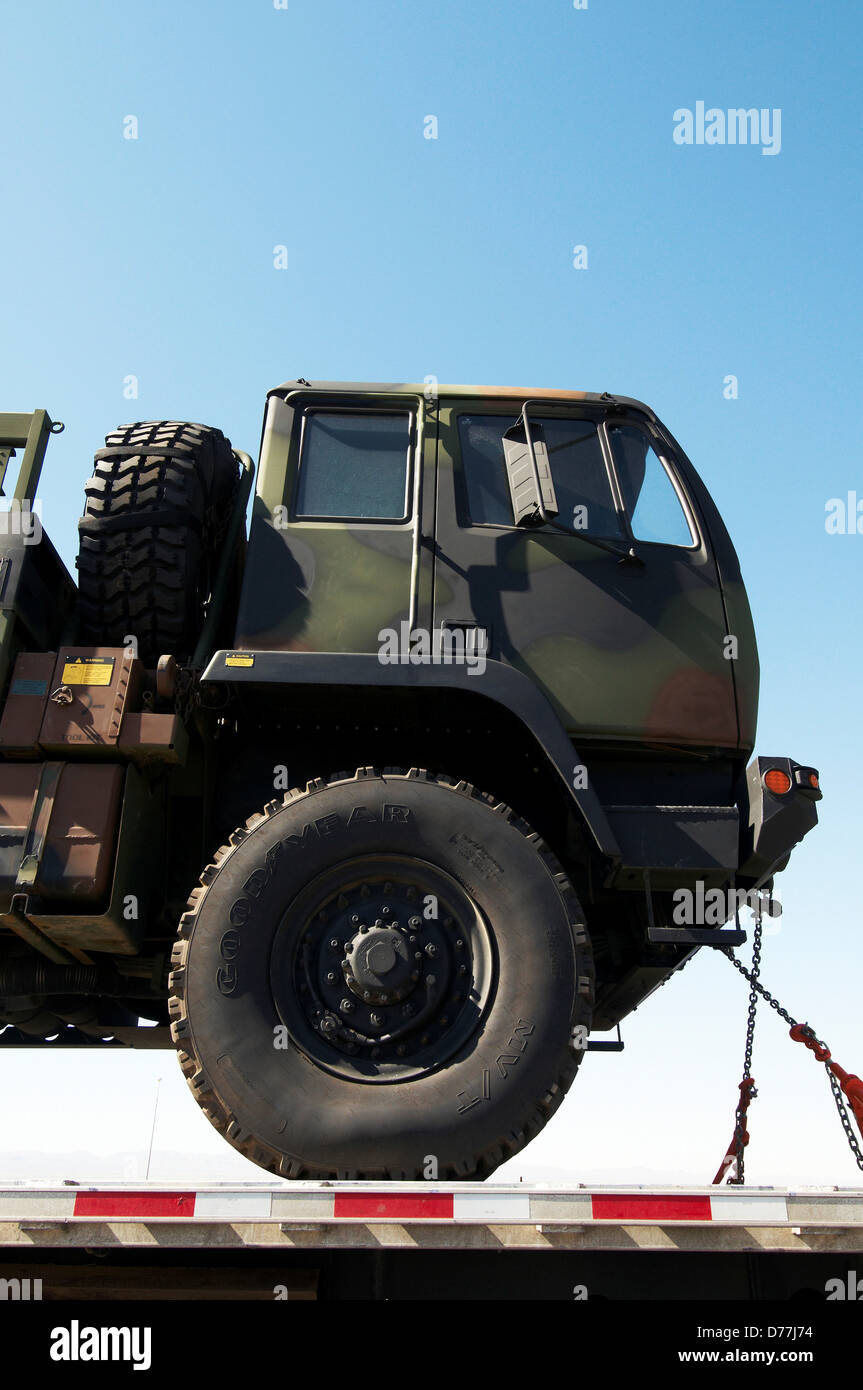 Military transport truck on back flatbed truck Texas USA - Stock Image