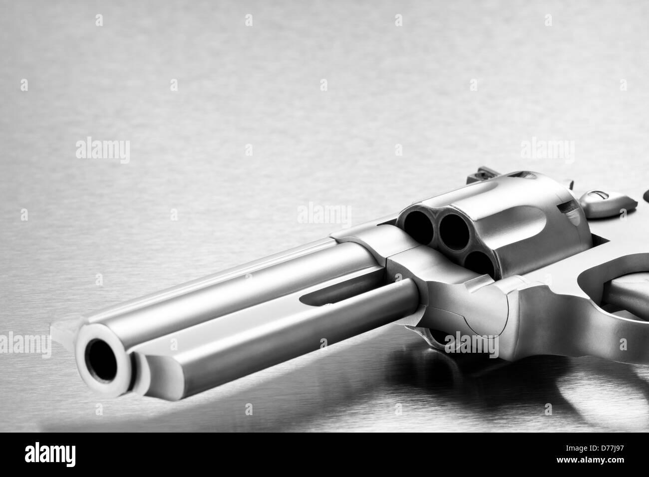 handgun on steel background - modern revolver closeup with copyspace. Focus on cylinder. - Stock Image