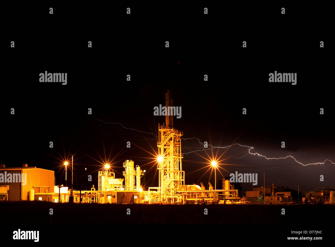 Night view petroleum processing facility lightning Weatherford Oklahoma USA Stock Photo