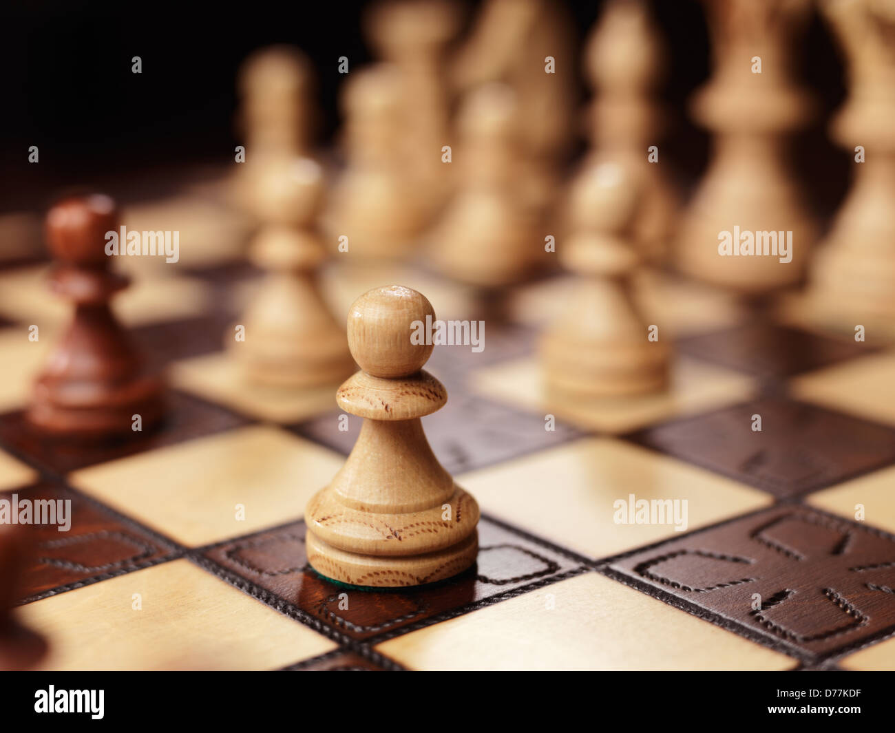Pawn chess piece on a chessboard - Stock Photo