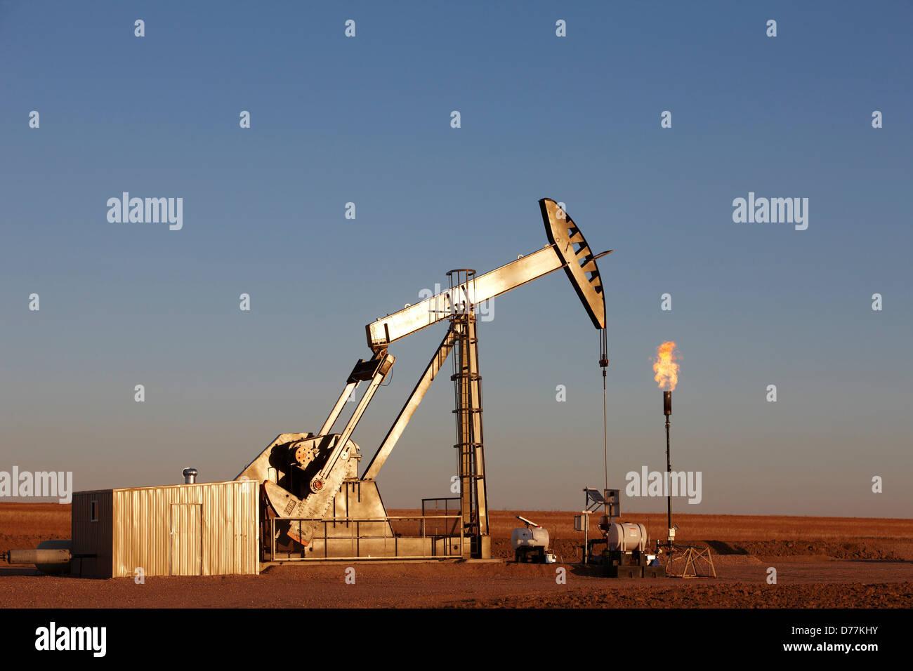 Oil well pumpjack pump jack gas flare flare stack eastern