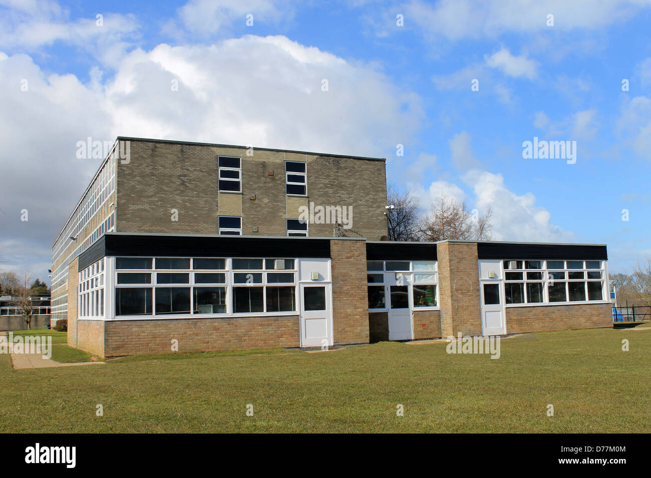 Exterior of secondary comprehensive school with blue sky and cloudscape background. - Stock Image