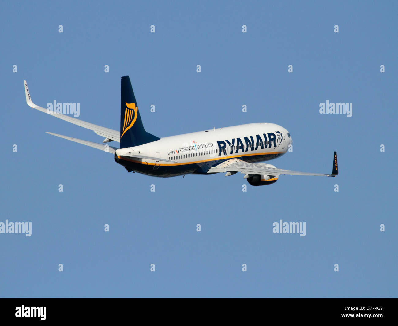 Economy air travel. Boeing 737-800 airliner belonging to low-cost airline Ryanair in a climbing turn on takeoff - Stock Image