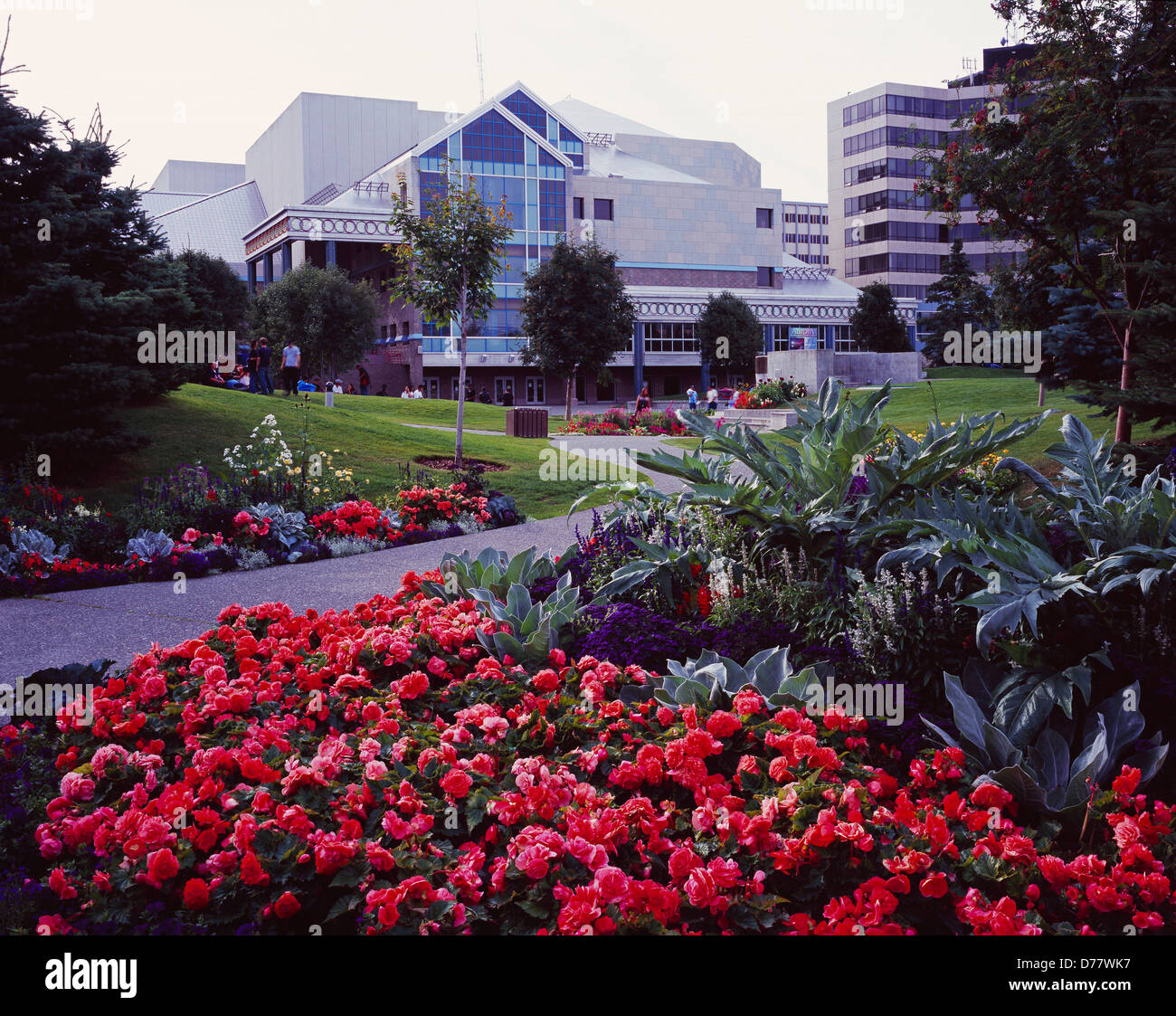 Gardens in Town Square Park Performing Arts Center beyond downtown Anchorage Alaska. - Stock Image
