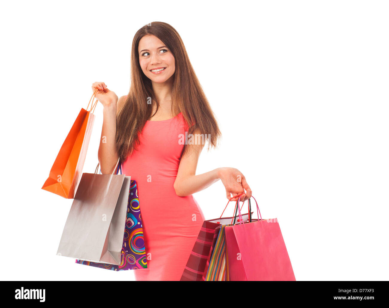 Pretty woman shopping, holding shopping bags, isolated on white - Stock Image