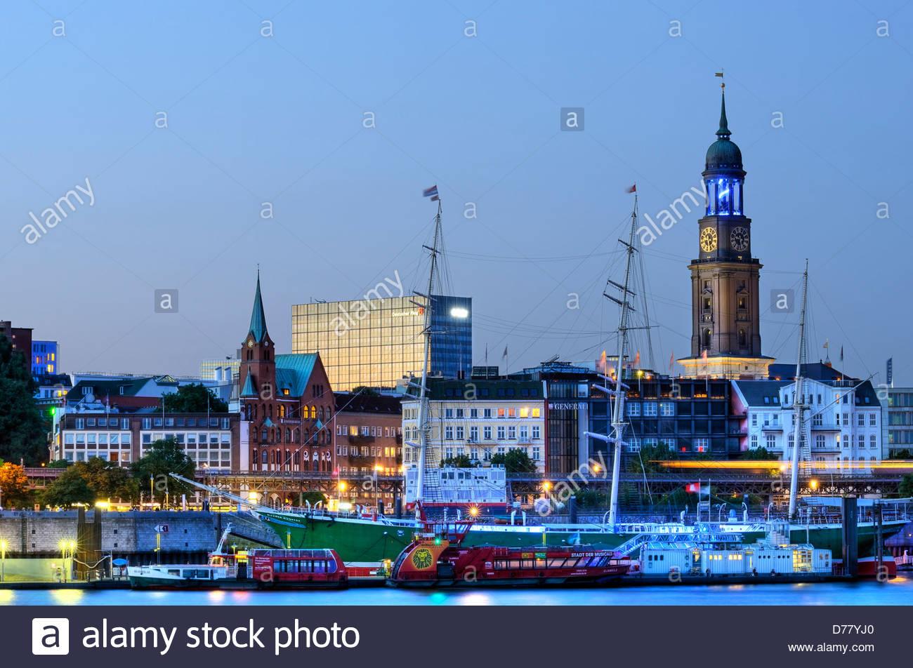 Illumination Blue port of Michael Batz, church Saint Michaelis and harbour shore in Hamburg, Germany, Europe - Stock Image