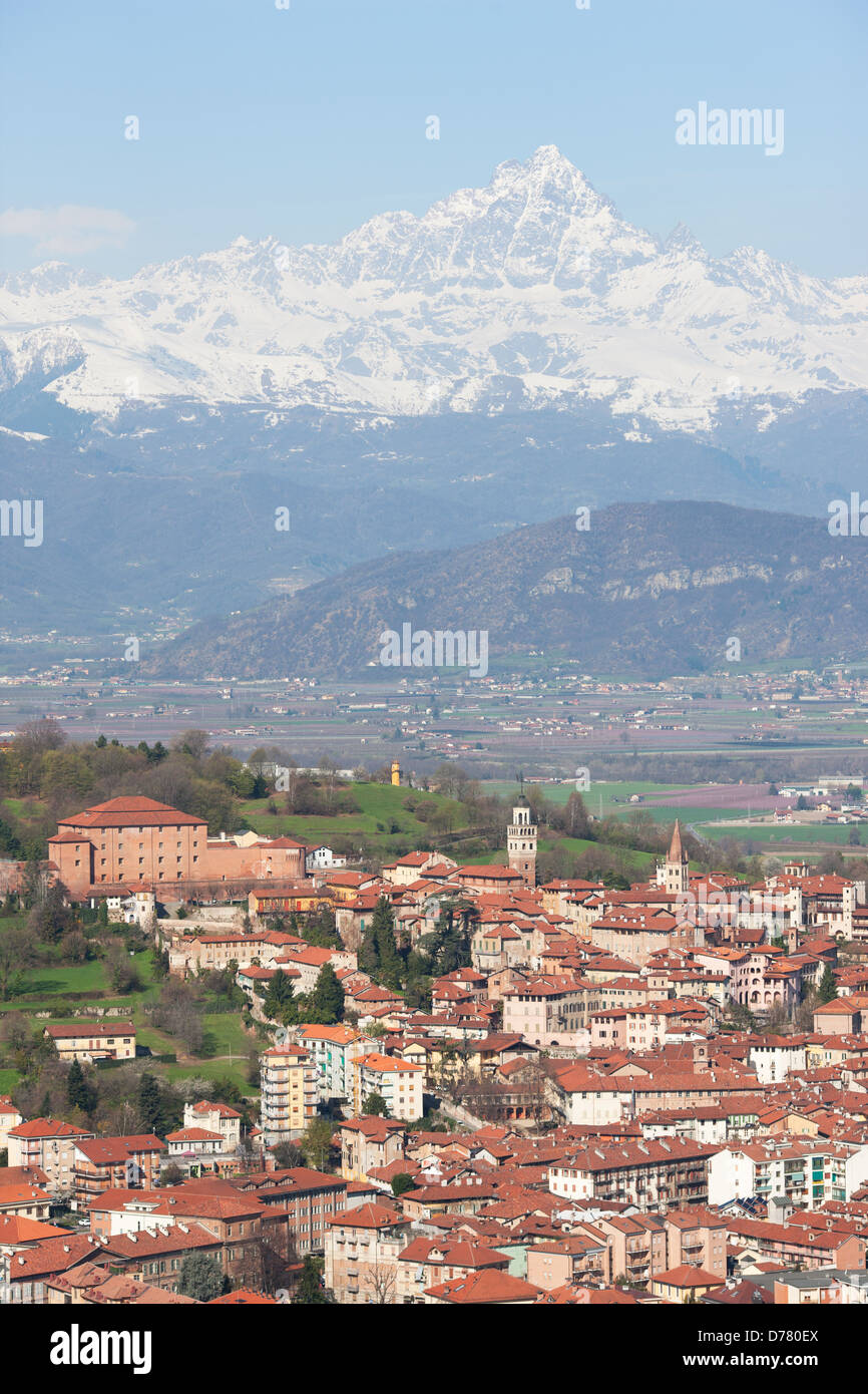 HISTORIC TOWN OF SALUZZO (aerial view). 3841-meter-high MONTE VISO in the distance. Italian Alps, PIedmont, Italy. - Stock Image
