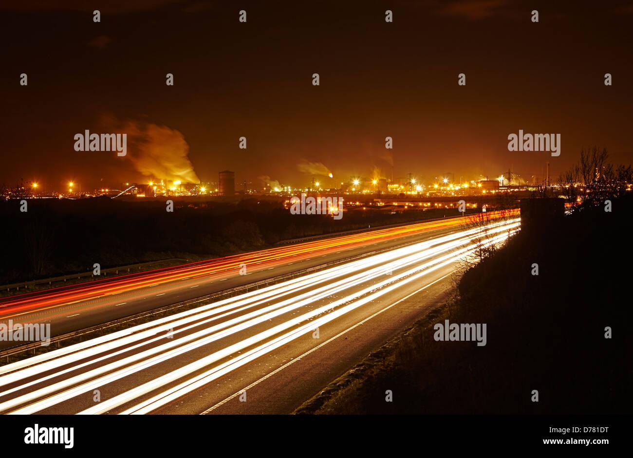 M4 Motorway traffic passing the Corus Steelworks in Port Talbot, Wales, UK - Stock Image