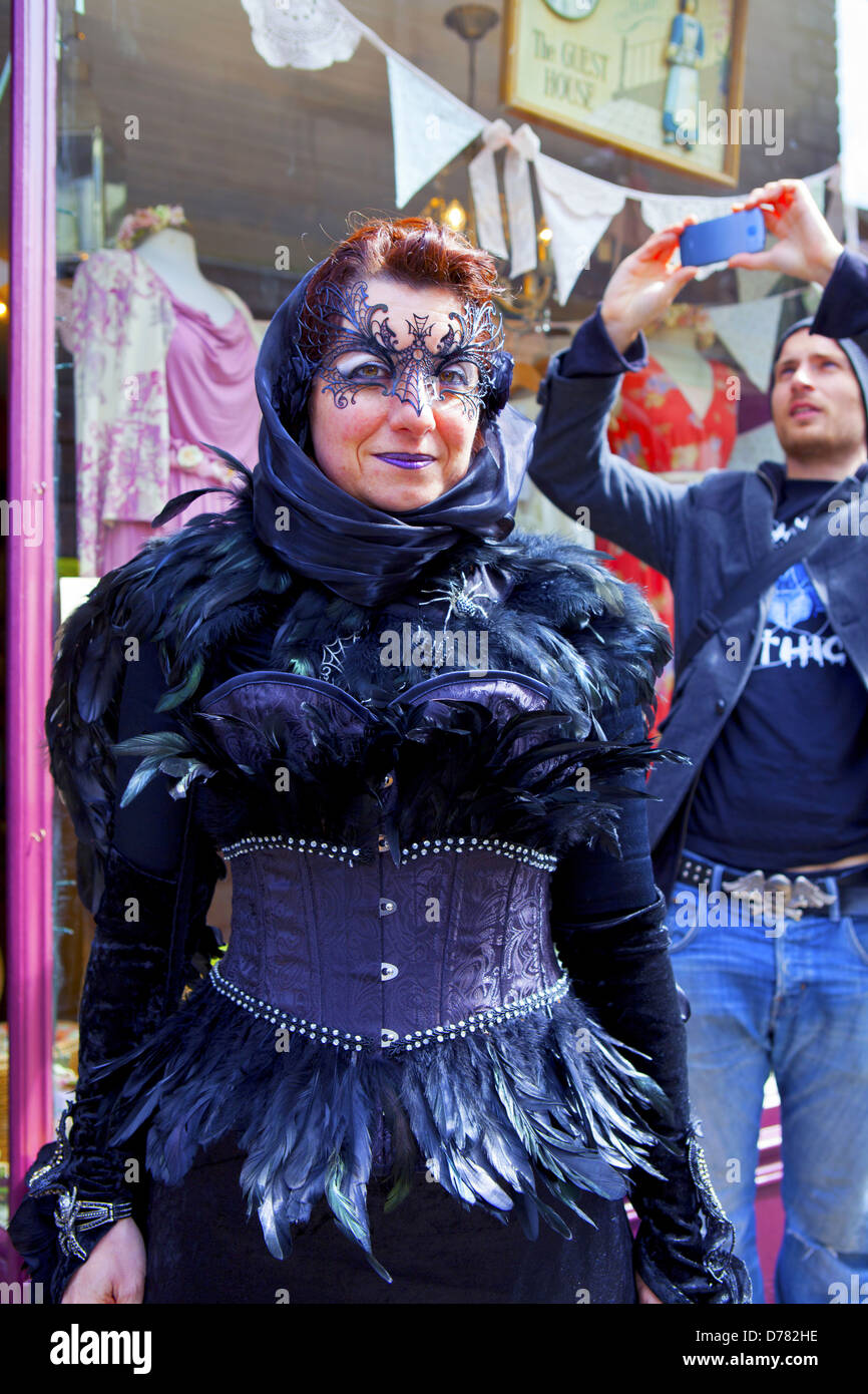 Street scene with masked Goth woman being photographed in Whitby at the  Gothic Weekend on 27, April, 2013. - Stock Image