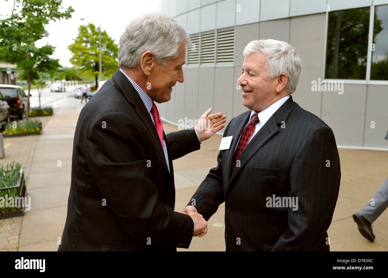 US Secretary of Defense Chuck Hagel is greeted by Fred Downey before meeting with the Aerospace Industries Association - Stock Image