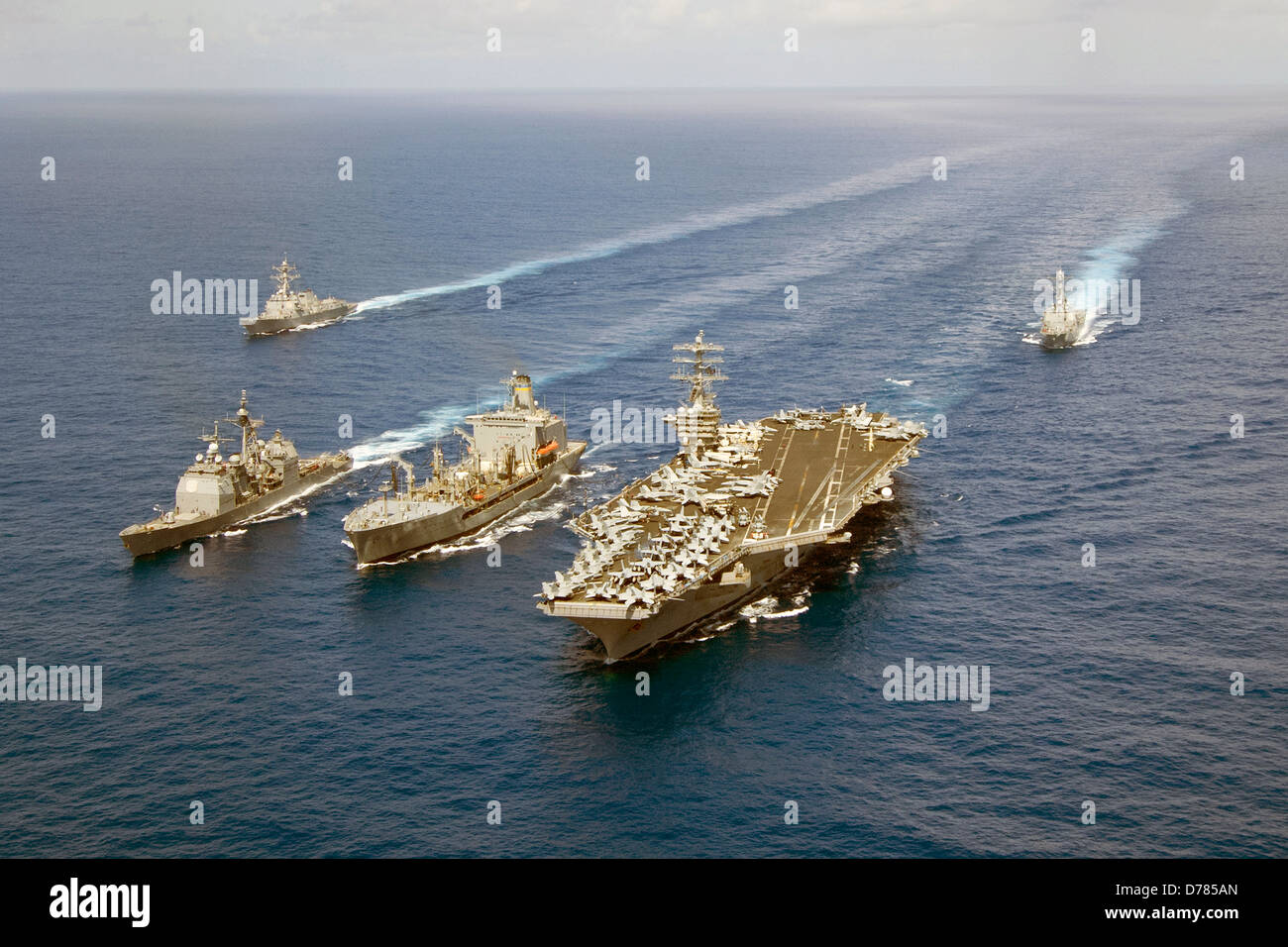 US Navy guided-missile cruiser USS Princeton, Military Sealift Command fleet replenishment oiler USNS Guadalupe, - Stock Image