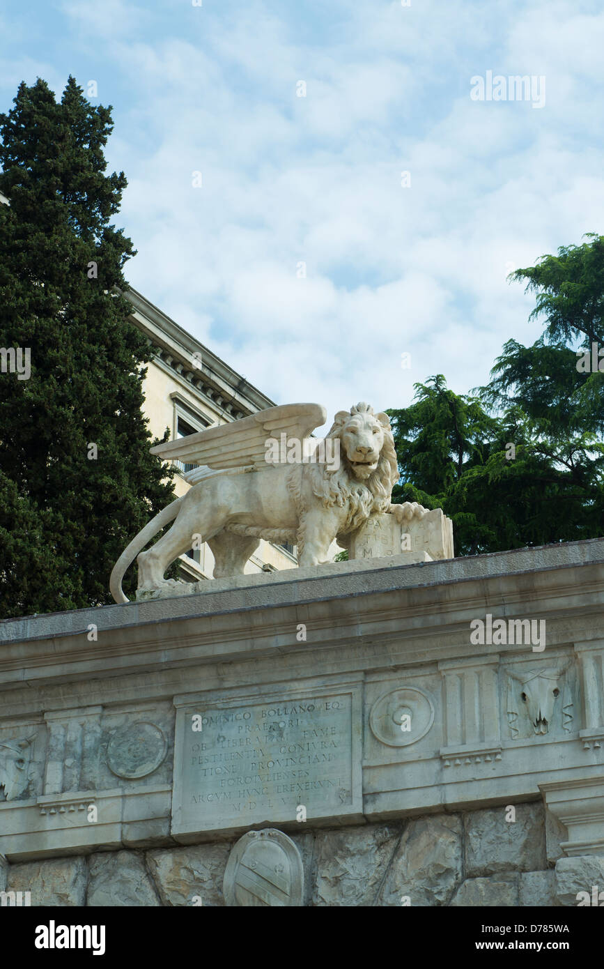 The statue of Venetian Lion up the gate to uphill the castle of Udine - Stock Image