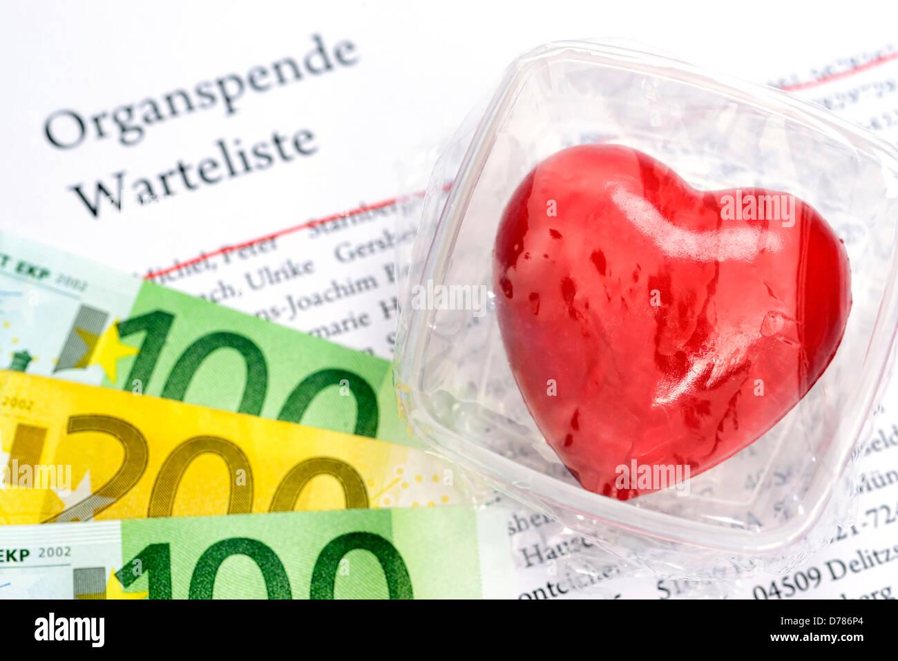 Heart in fresh hold box and organ donation vantage point list, symbolic photo organ donation - Stock Image