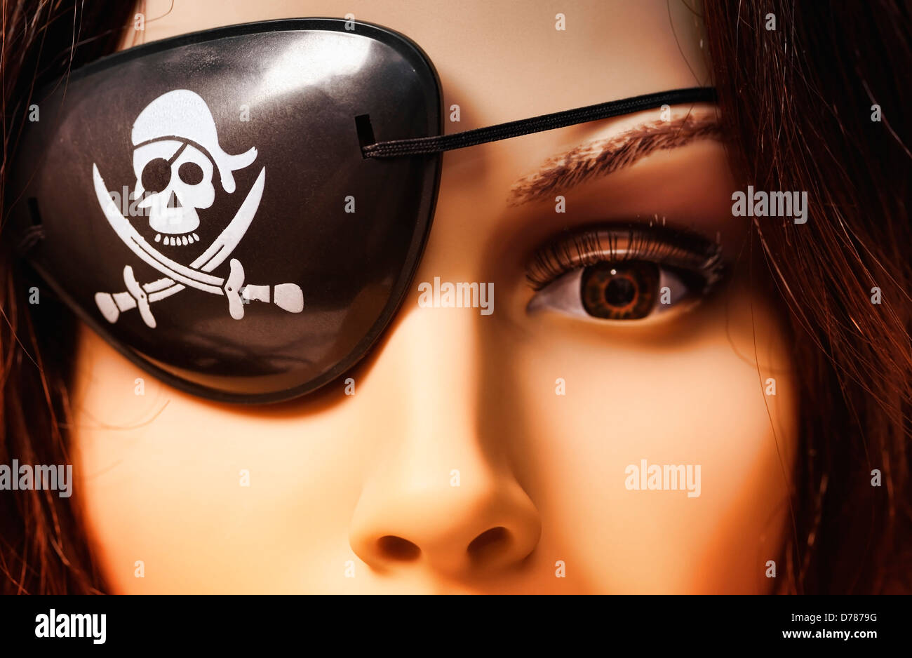 Doll with pirate's eye patch, symbolic photo pirate's party - Stock Image