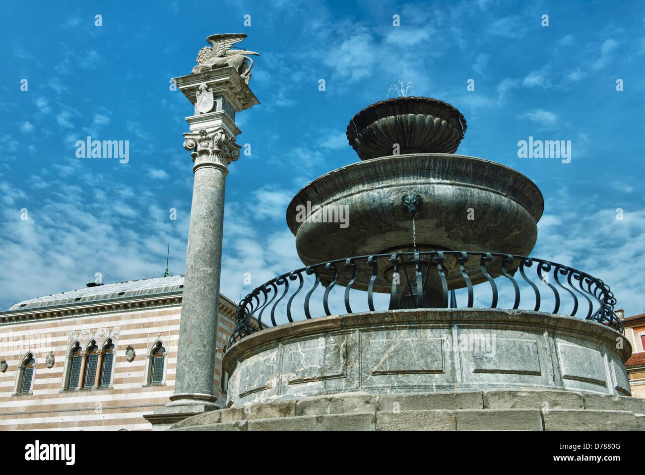 The fountain in Piazza Libertà in Udine - Stock Image