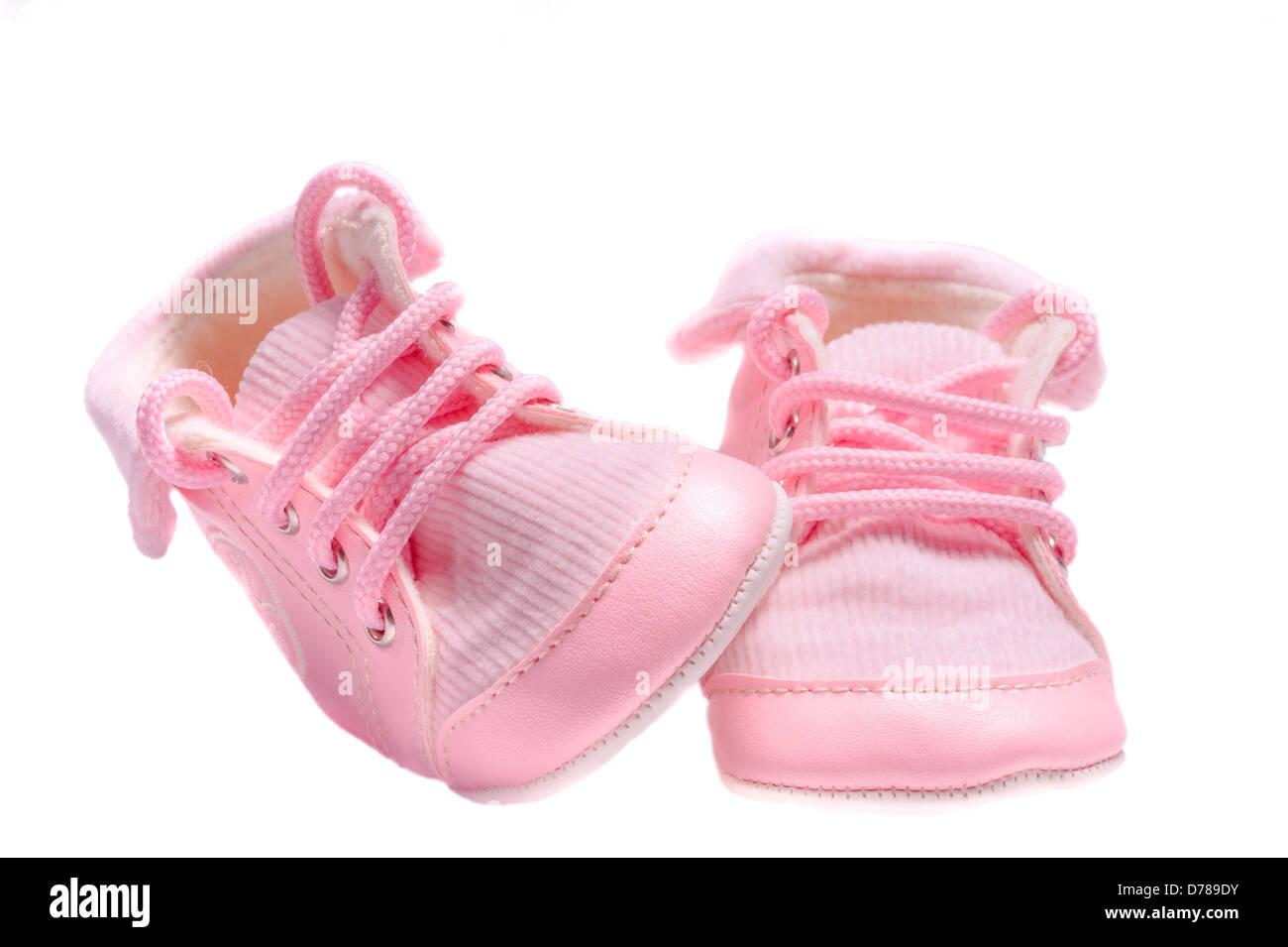 pink velvety baby shoes Isolated on white background - Stock Image