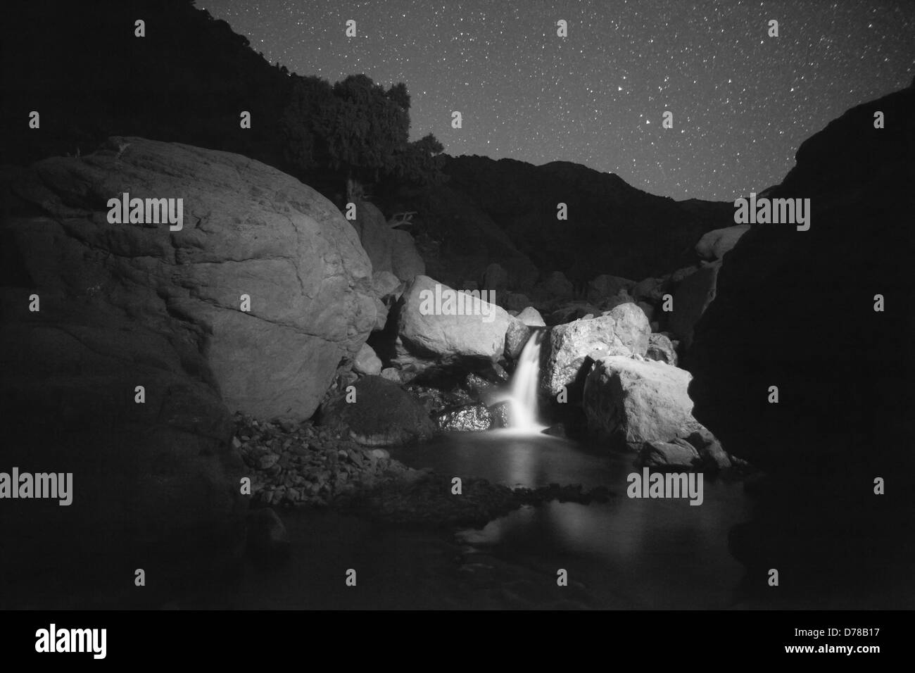 Moonlit waterfall in the Atlas mountains - Stock Image