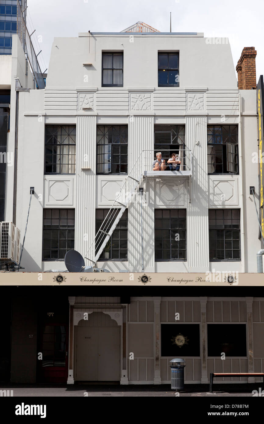 Old house in Aucklandwith two people sitting in the sun Stock Photo